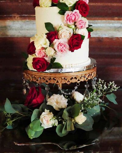 Wedding cake with cascading fresh flowers
