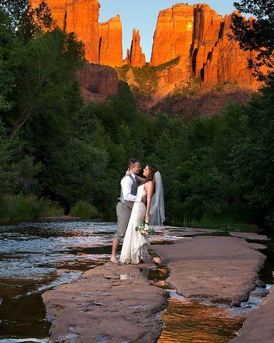 Bride and groom holding each other at red rock crossing in sedona arizona