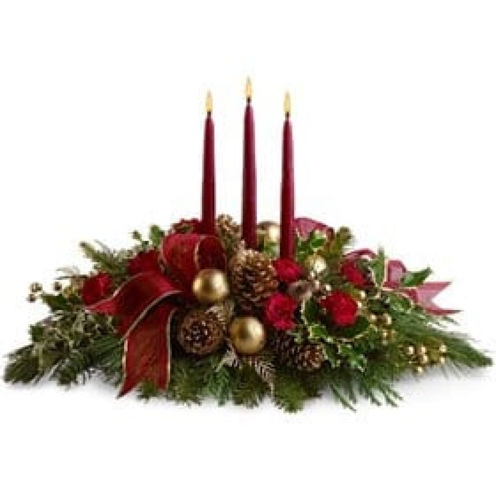 A christmas floral arrangement with 3 candles