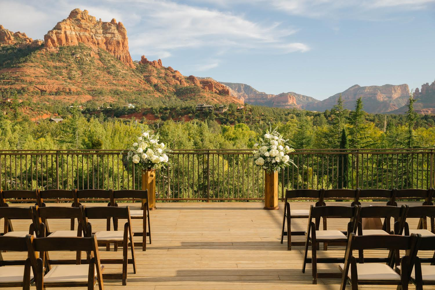 wedding venue with two standing bouquets and sedona red rock mountains in the background
