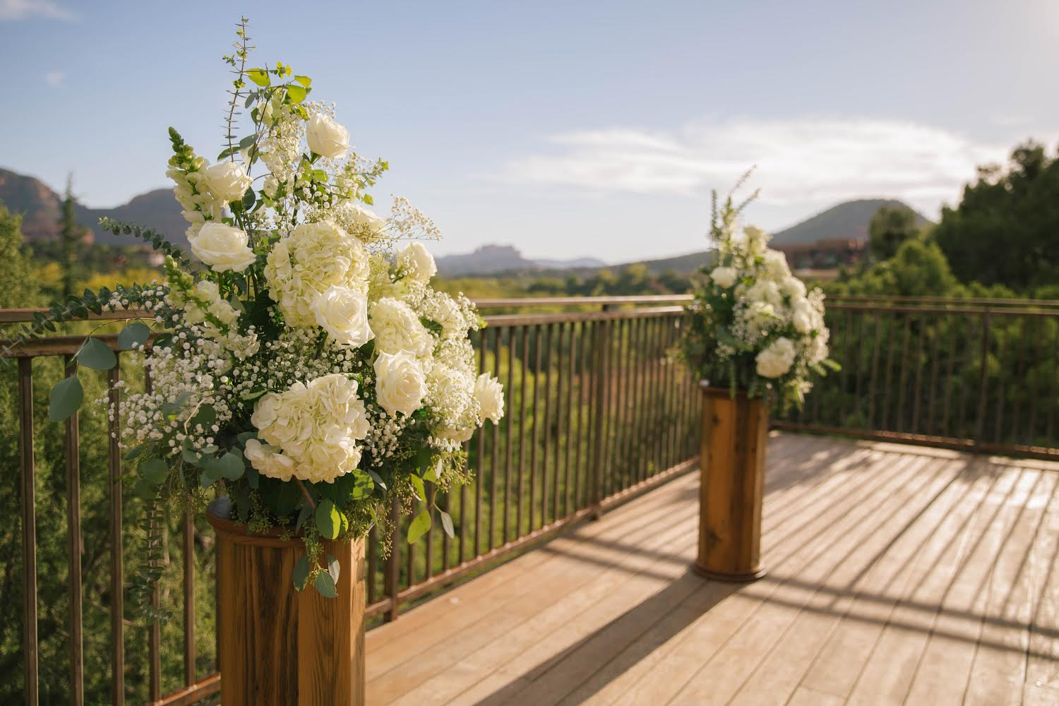two standing floral arrangements at agave of sedona wedding resort