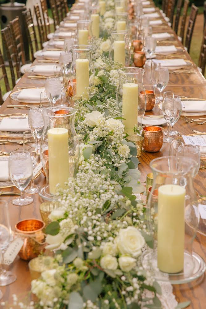 table floral arrangement with white flowers and candles