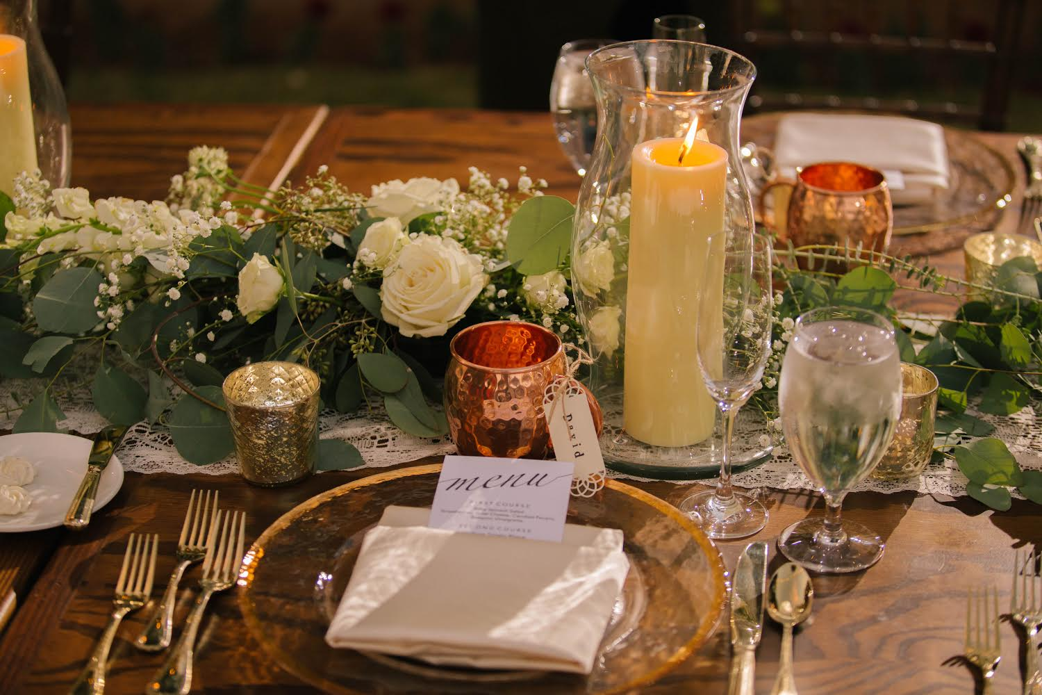 wedding table floral arrangement with candle